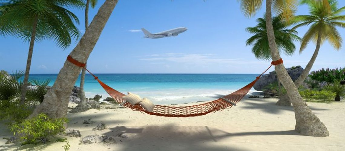 13496727 - exotic travel composition with a flying plane, a tropical beach with a hammock hanging from palm trees