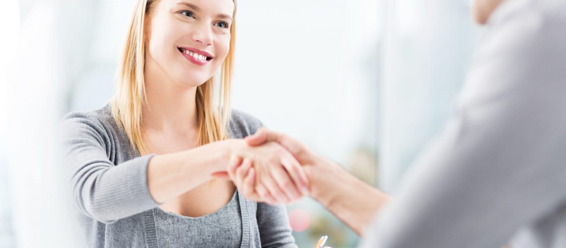 34211619 - businesspeople shaking hands