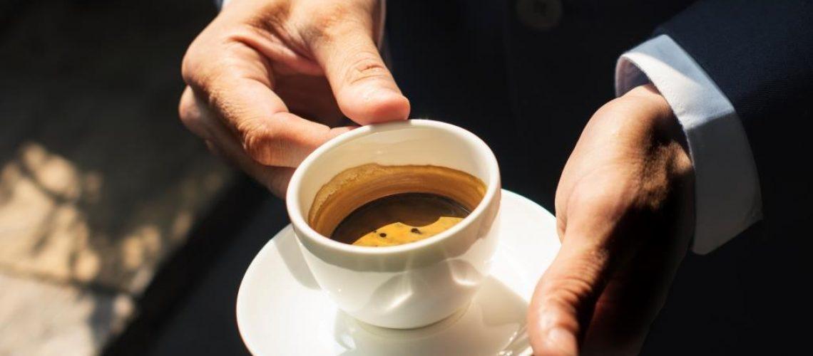 a-businessman-having-coffee-PZ36CMW