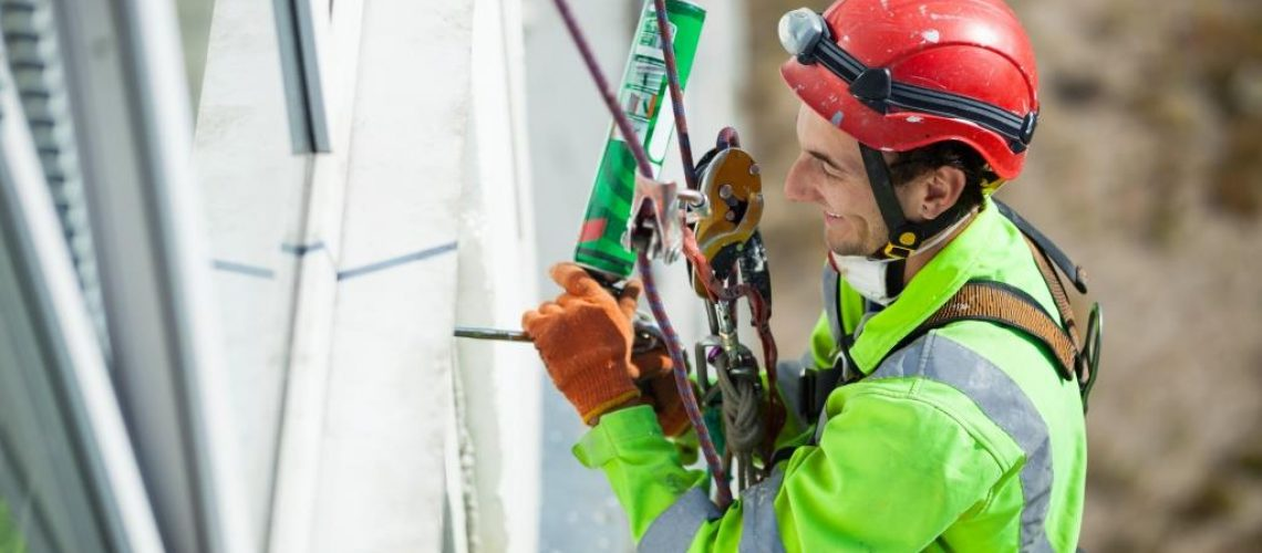 Cheerful industrial climber during winterization works